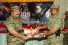 LTTE leader receiving the first copy of Black Tigers, volume 09, from LTTE Political Head B. Nadesan