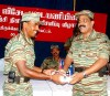 LTTE's Special Commander for Trincomalee Col. Sornam (right) hands over special prize to Mr.Kilman, training instructor
