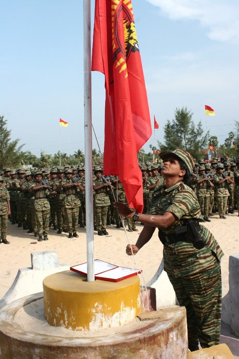 Col. Yarlini (Vithusha), Special Commander of the Malathi Women Regiment of the LTTE, hoisting the flag at the sports event.
