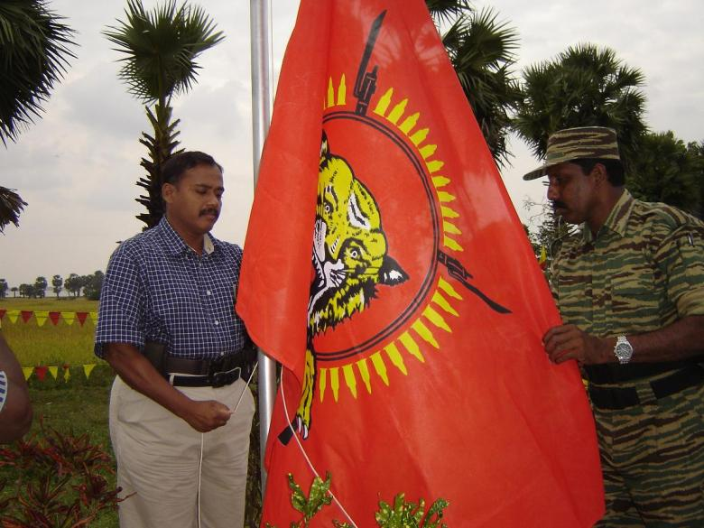 Col. Banu hoisting the National flag