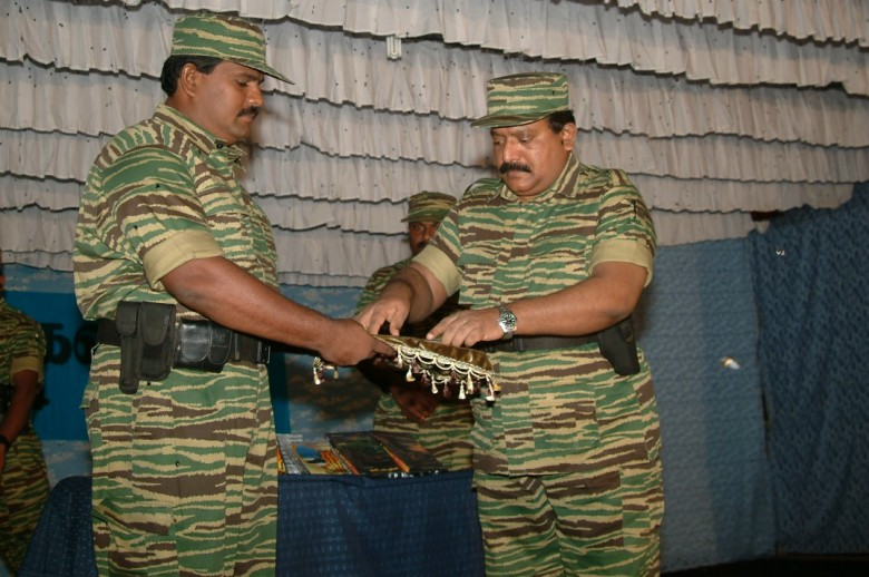 Col. Soosai, Special Commander of the Sea Tigers hands over the first copy of the music album