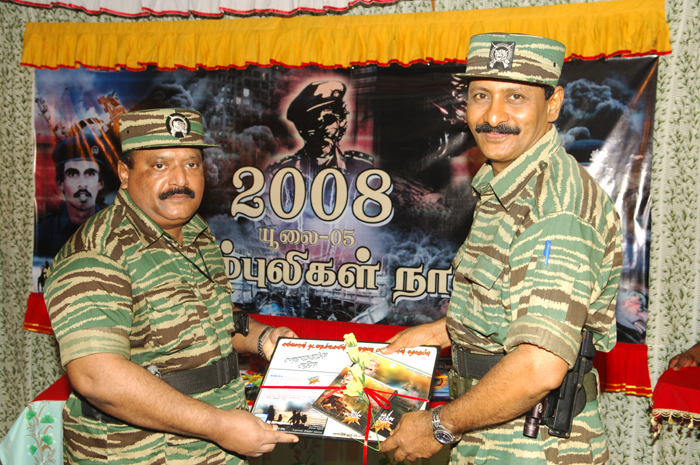 Mr. Pirapaharan receiving the first copy of 'Surprise Attack in Anuradhapuram', a music album, from Poddu Ammaan, head of LTTE intelligence wing