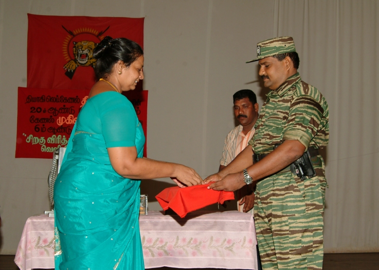 The wife of late Col. Shankar, Ms Kuga, receiving the first copy of the music CD titled Airborne Tigers